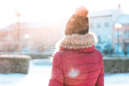 woman-standing-in-snowfall-while-sun-is-shining-picjumbo-com